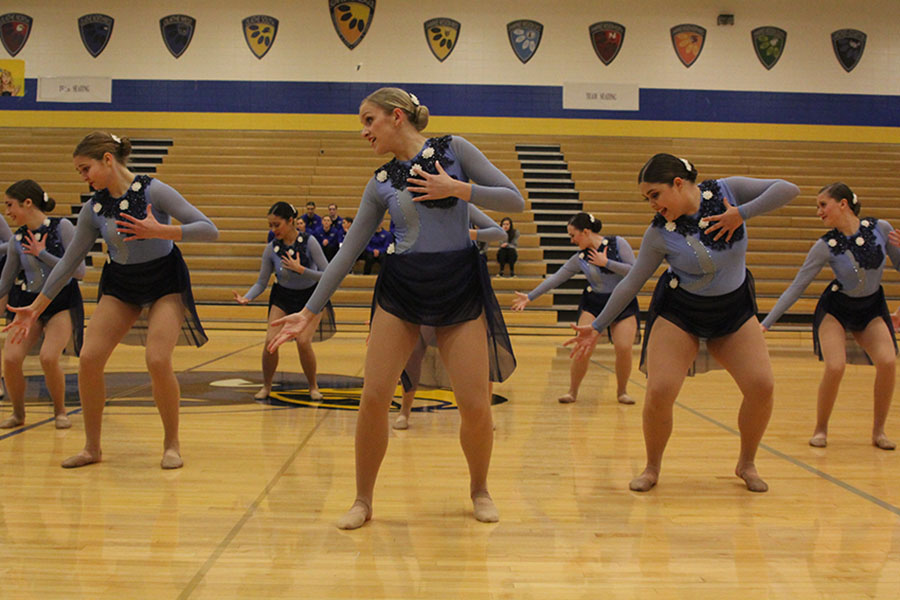 During+the+jazz+routine%2C+which+was+awarded+the+Outstanding+Choreography+Award+at+Miss+Kansas%2C+senior+Bella+Line+places+her+hand+over+her+chest.+