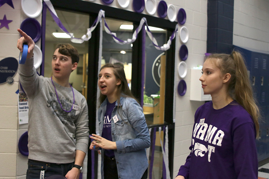 Working together, seniors Johannes Seberger, Jessie Coleman and Kate Backes were crucial members in the preparation for the purple bomb and Relay for Life rally held on Friday, Jan. 11.