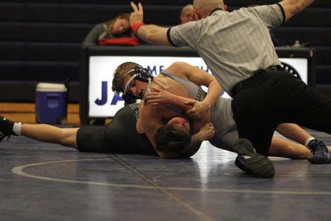 Jaguars wrestle De Soto in senior night dual
