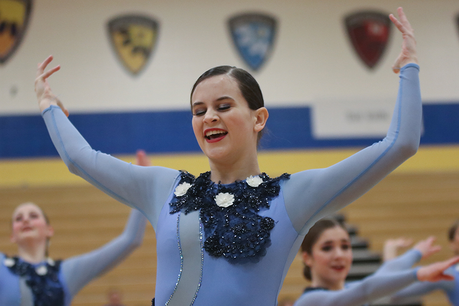 Throwing+her+arms+in+the+air%2C+senior+Olivia+Augustine+looks+down+towards+the+ground+at+the+Miss+Kansas+dance+competition+held+at+Olathe+South+High+School+on+Sunday%2C+Jan.+20+and+Monday%2C+Jan.+21.