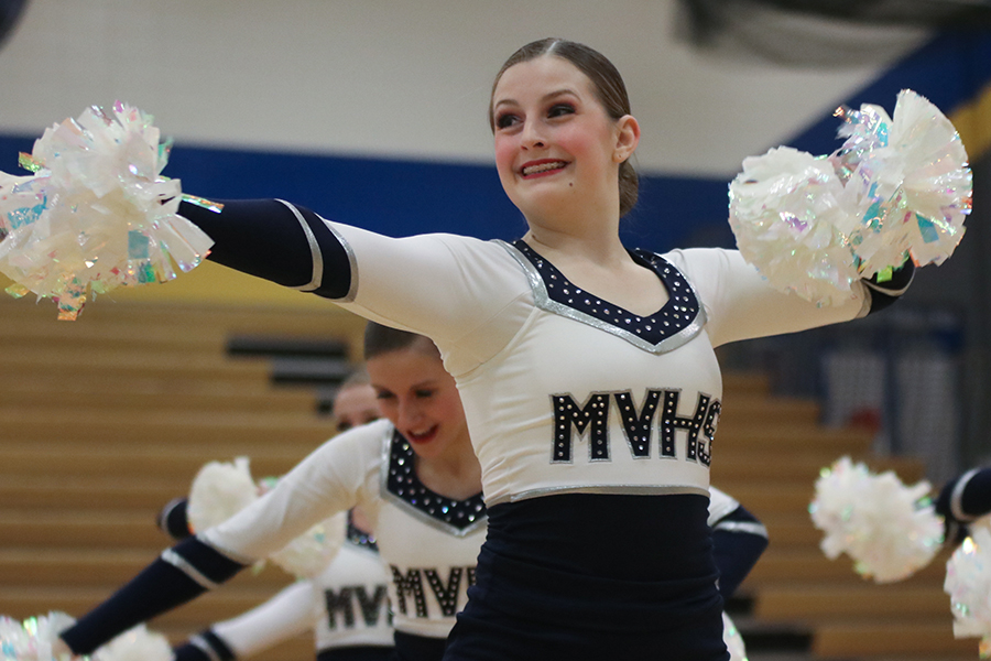 During+the+pom+routine%2C+sophomore+Kenzie+Harris+looks+to+fellow+dancers.+