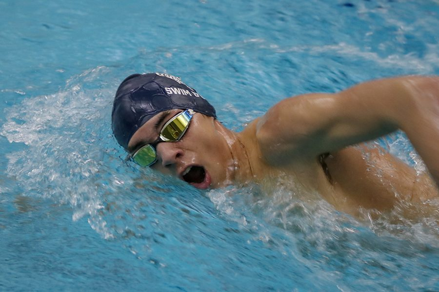 Coming up for air, sophomore  Cole McClure l competes in the 200-yard freestyle. Boys swim finished second at the Olathe South Swim Meet on Wednesday, Jan. 16.
