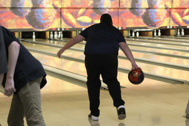 Preparing+to+roll+the+ball%2C+junior+Bri+Davis+swings+it+forward.