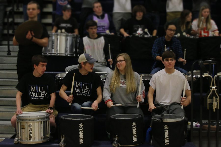 In order to hype up the crowd, the drumline performs a song during a time out.