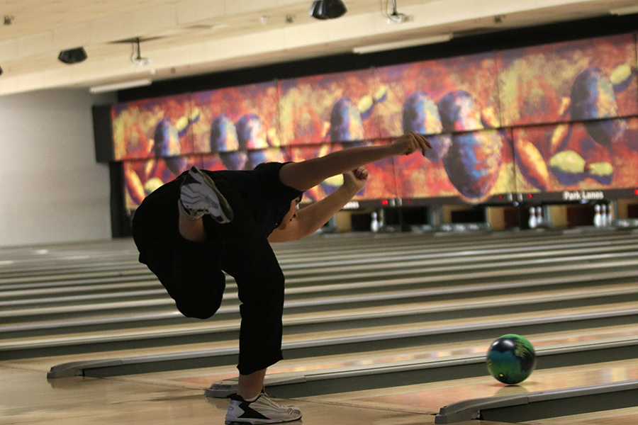 After throwing the bowling ball, sophomore Devin Kuhlman knocks down all ten pins and gets a strike. He ended with a final score of 507 at the bowling meet on Thursday, January 17.