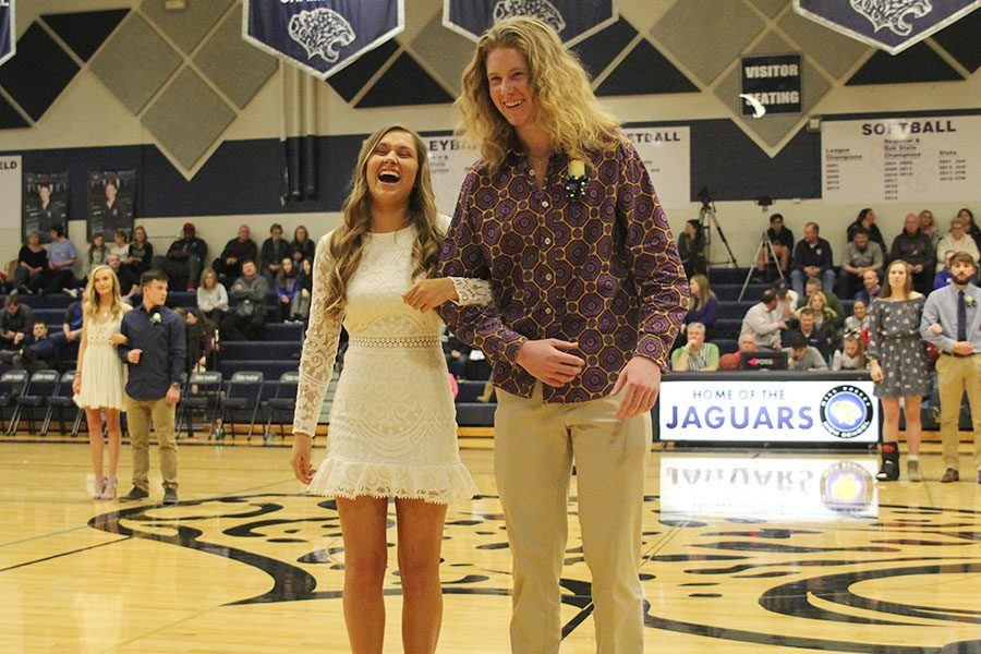 Laughing as they try and hook arms, senior WOCO candidates Ashton Rider and Killian O'Brien meet at center court.