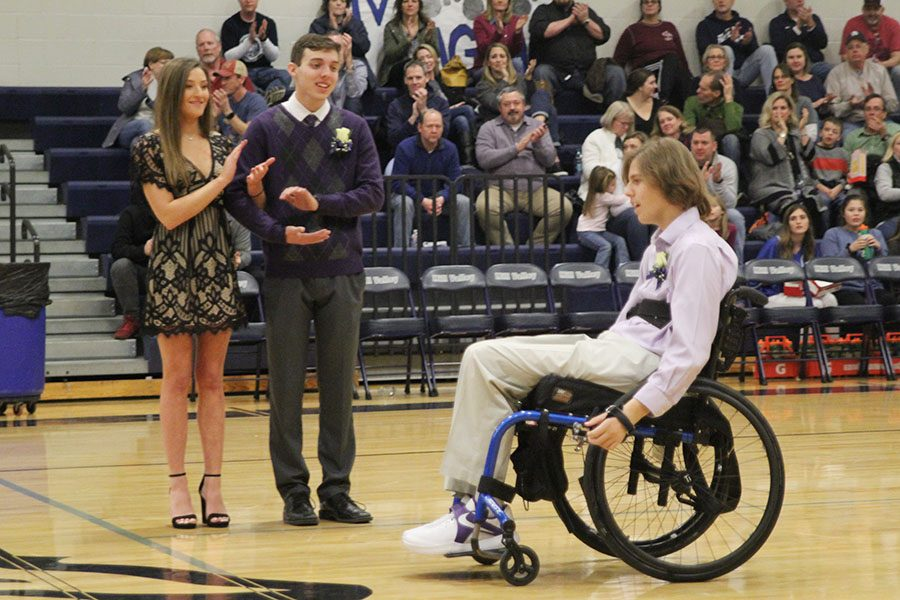 Following senior Nolan Sprague's announcement as WOCO king, fellow candidates seniors Lydia McDaneld and Joe McClain applaud.
