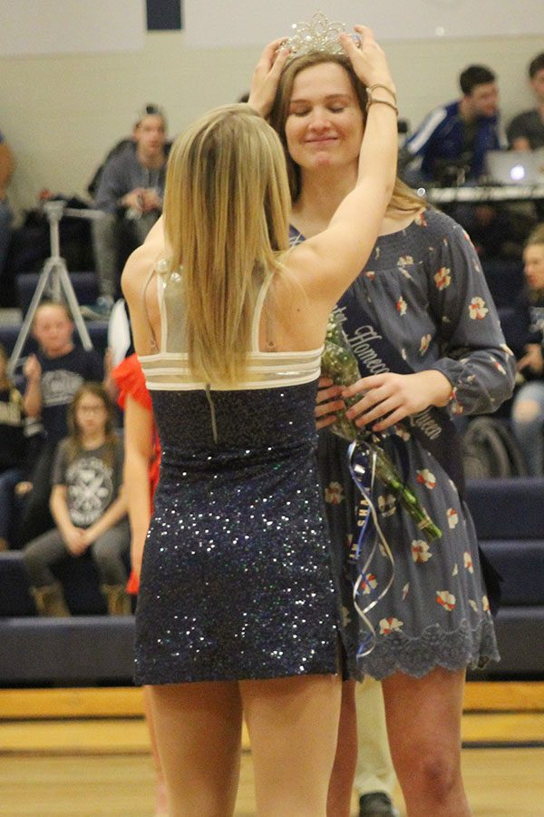 After being pronounced WOCO queen, senior Claire Kaifes receives her crown from senior Bella Line.