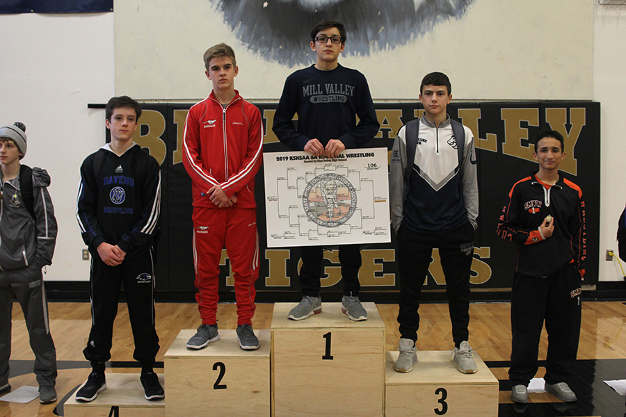 Stepping+up+to+the+podium+sophomore+Liam+Sutton+becomes+2019+6A+Regional+champion+in+the+106lb+weight+class.