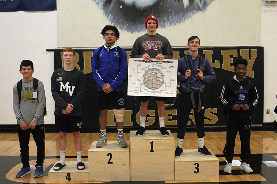 Accepting+his+medal%2C+sophomore+Carson+Dulitz+places+fourth+at+regionals+in+the+126lb+weight+class.