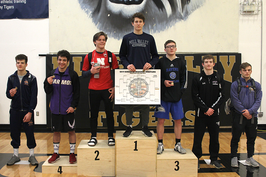 Standing+at+the+top%2C+sophomore+Brodie+Scott+becomes+2019+6A+Regional+champion+in+the+152lb+weight+class.