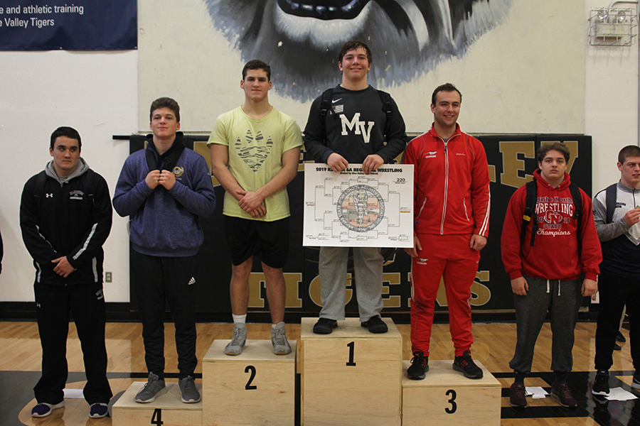 With+a+smile+on+his+face%2C+senior+Ethan+Kremer+becomes+2019+6A+Regional+champion+in+the+220lb+weight+class.