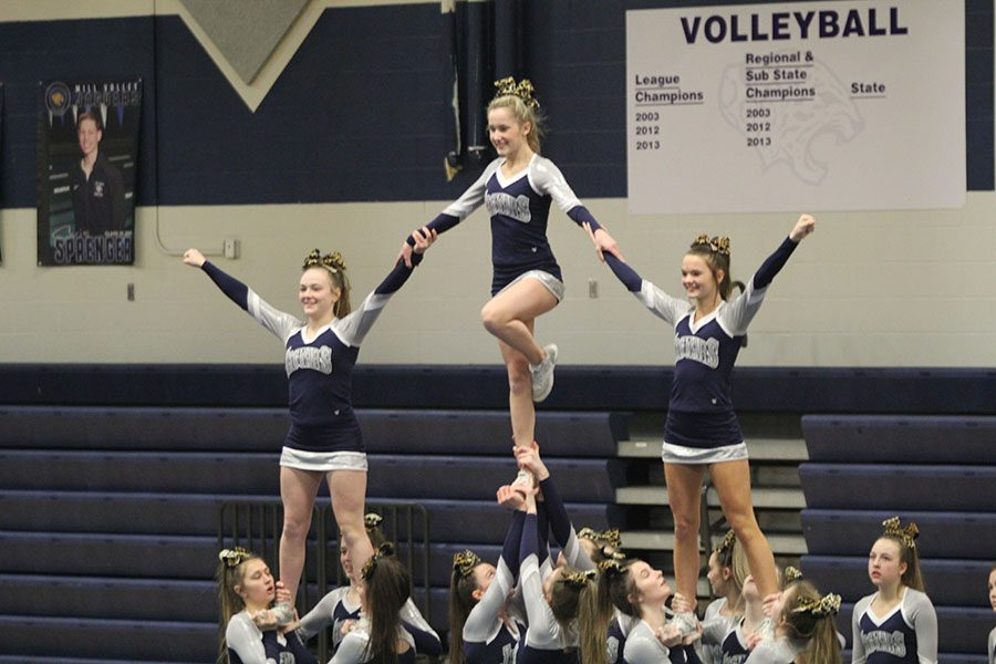 As their last move for the De Soto Cheer Showcase on Monday, Feb. 25, the cheer team performs a stunt.