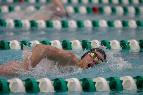 In the middle of the freestyle stroke, sophomore Cole McClure takes a breath of air and continues on with the 500 Yard Freestyle. McClure finished 2nd in his heat at the EKL Swim and Dive Championships on Saturday, Feb. 2.