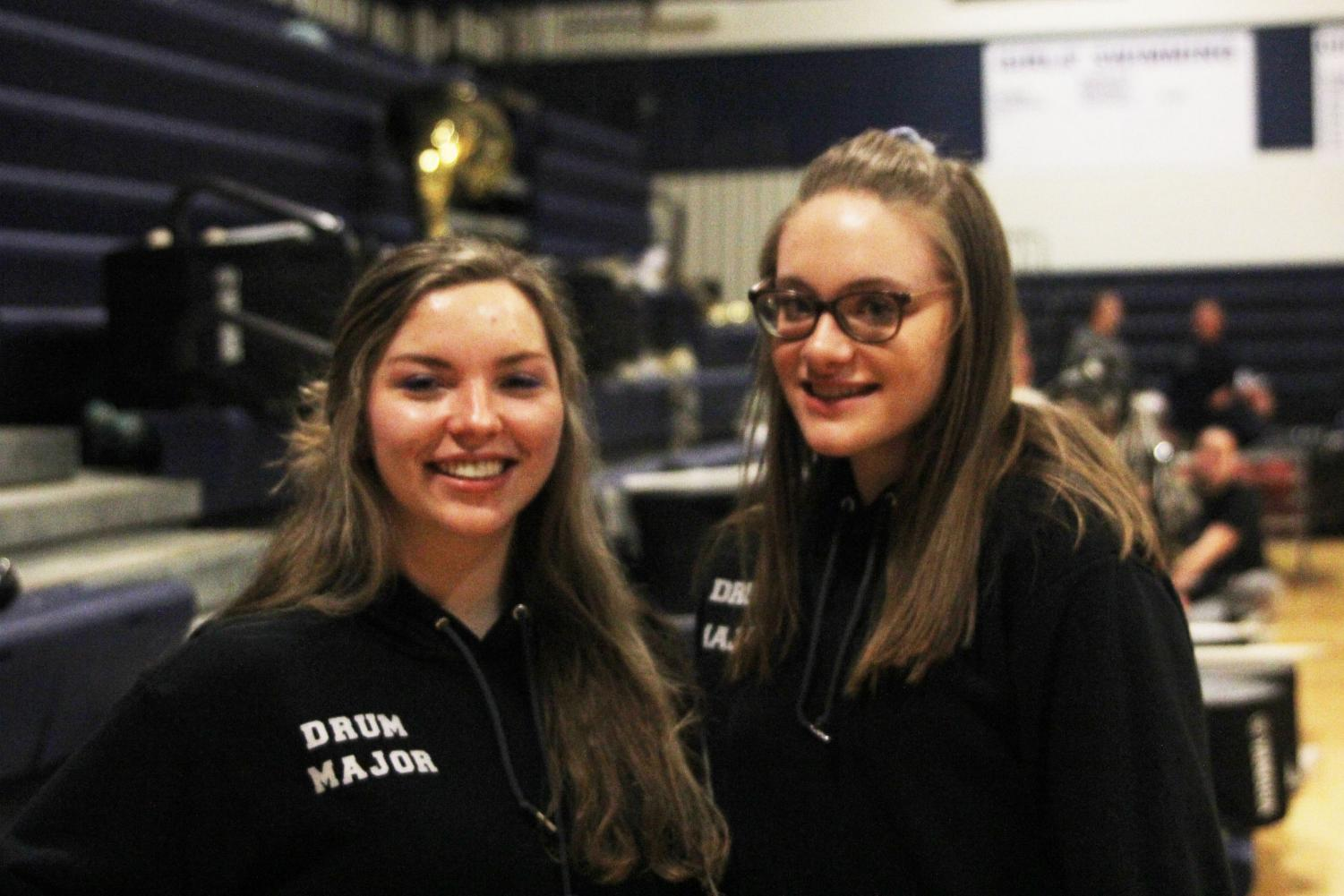 Junior drum majors Kaleigh Johnston and Amber Guilfoil stand in front of the band section during the girl's basketball game on Thursday, Feb. 21