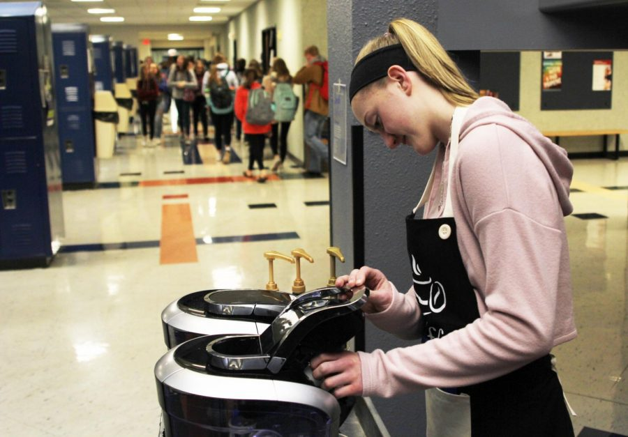 "Preparing for the typical morning rush, senior Ally Appl places a Keurig K-Cup into the coffee maker on Tuesday, Jan. 22. ""Usually we get a lot of business and sell a lot of coffee,"" Appl said."