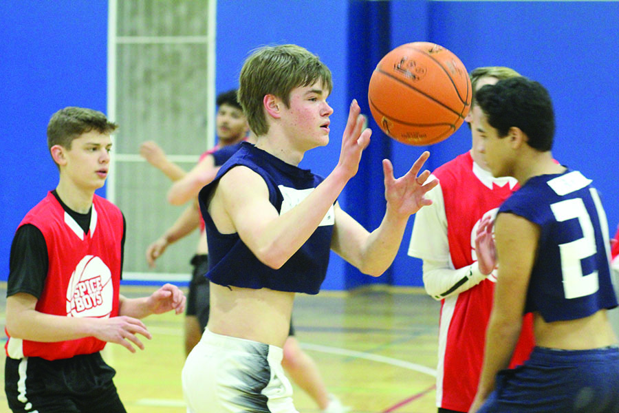 """During a game against the Spicy Boys, junior Jake Keller looks to receive a pass from his teammate on Tuesday, Jan. 29. """"I like playing with and against my friends and everyone's having fun while it's still competitive,"""" Keller said."""