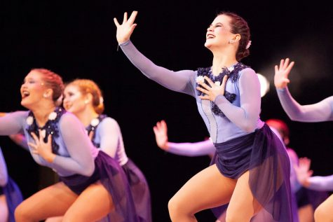 While performing a jazz routine, senior Olivia Augustine reaches out to the crowd.