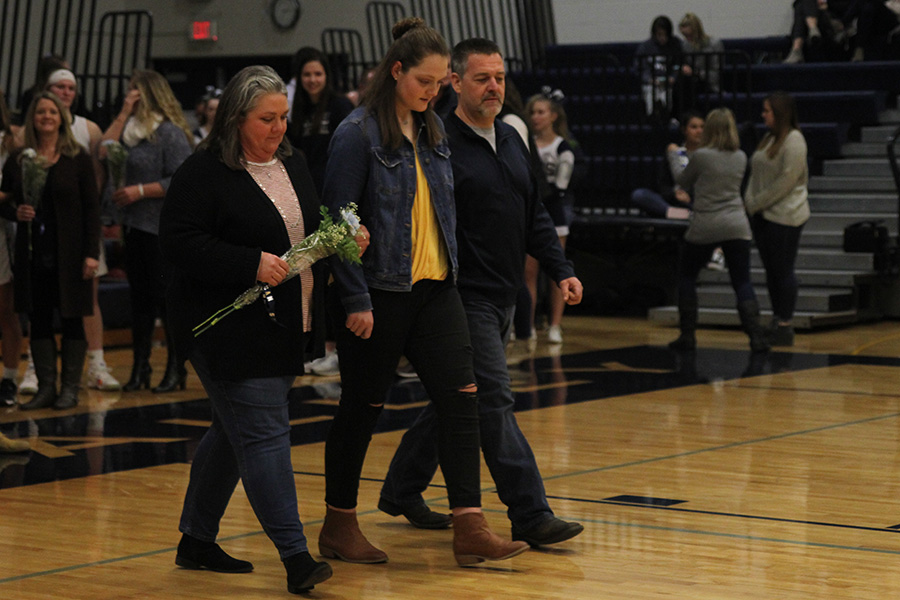 As+she+is+introduced+for+senior+night%2C+senior+Makayla+King+walks+out+with+her+parents.
