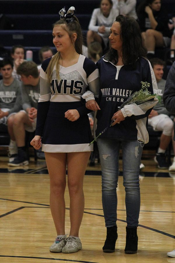 After she was introduced as a part of senior night, senior Ashton Rider stands with her mom.