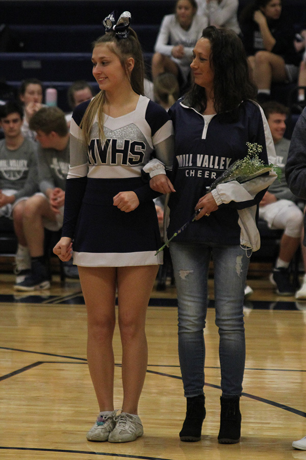 After+she+was+introduced+as+a+part+of+senior+night%2C+senior+Ashton+Rider+stands+with+her+mom.
