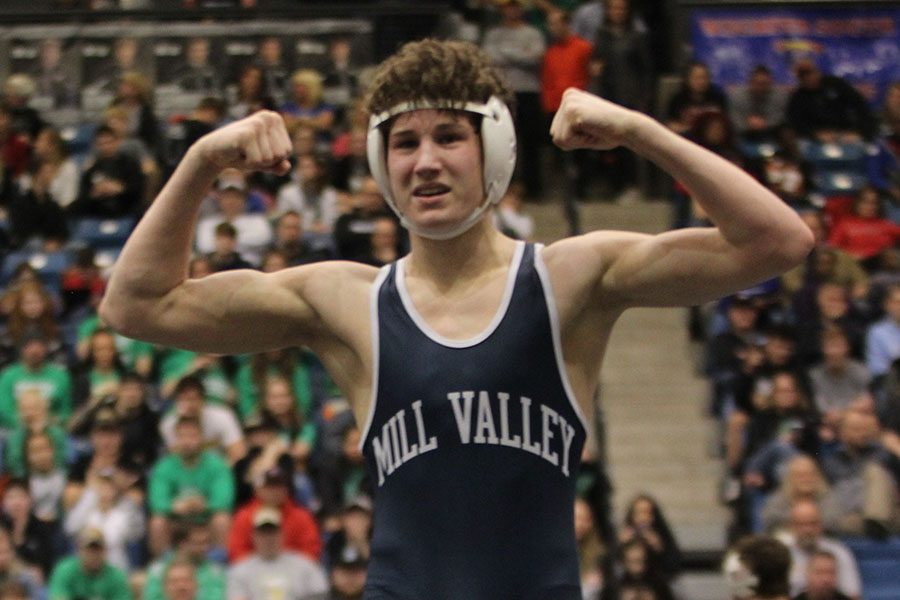 After placing third in his weight class, sophomore Brodie Scott flexes to the crowd.