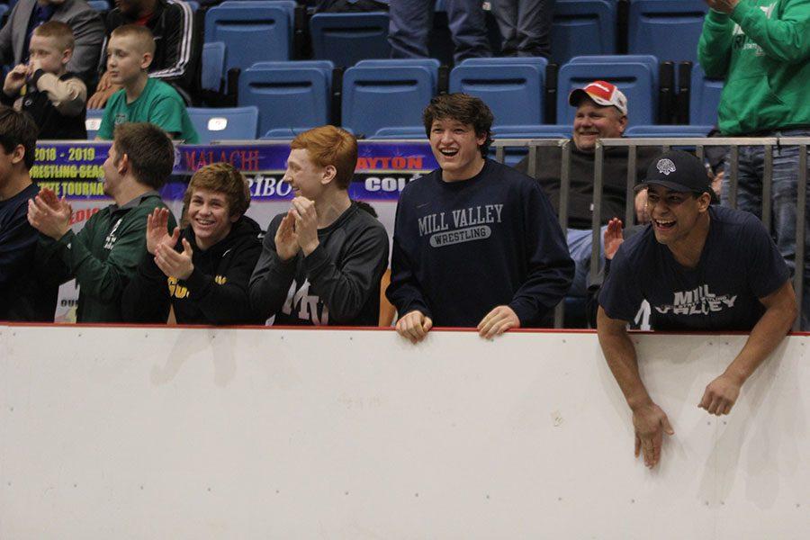After sophomore Ethan Kremer won the state championship title, members of the Jaguar wrestling team celebrate.
