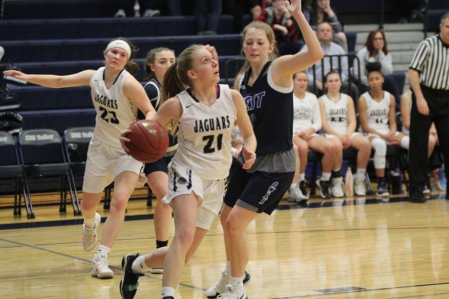 Looking up at the basket, senior Lexi Ballard strides to make a layup.