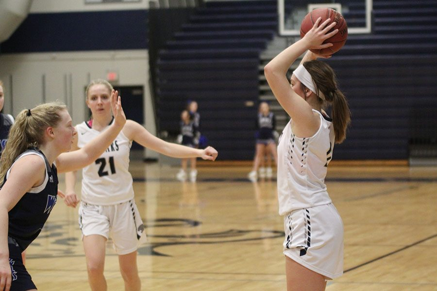After a foul on Olathe West, junior Ella Shurley scans the court for a player to throw the ball in bounds to.