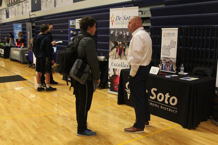 Junior Gilbert Vandegrift talks about education with Brian Schwanz from the Desoto school district.