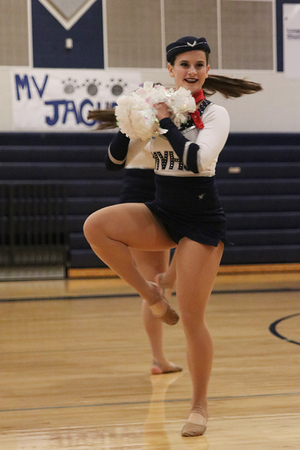 Doing+a+turn%2C+senior+Olivia+Augustine+performs+in+the+pom+routine+on+Saturday%2C+March+30.