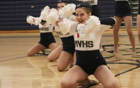 Arms up, junior Sydney Ebner performs in the pom routine at the annual spring show on Saturday, March 30, showcasing dances performed throughout the season.