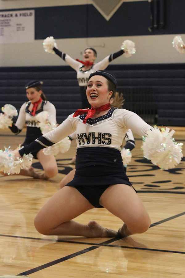 Falling+on+her+knees%2C+senior+Eve+Steinle+performs+in+the+pom+routine+at+the+spring+show+on+Saturday%2C+March+30.