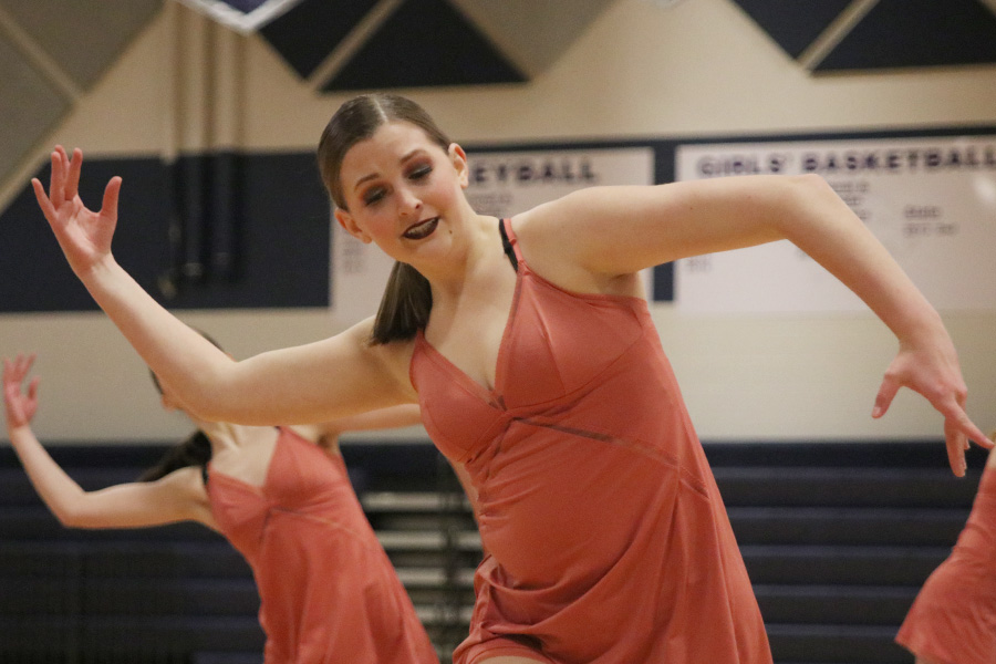 Moving+her+arms%2C+sophomore+Kenzie+Harris+dances+in+the+sophomore+ensemble+at+the+spring+show+on+Saturday%2C+March+30.