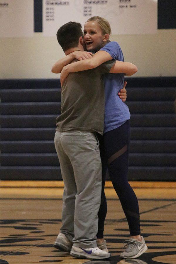 After the Super Stars dance on Saturday, March 30, seniors Bella Line and Matt Santaularia hug.