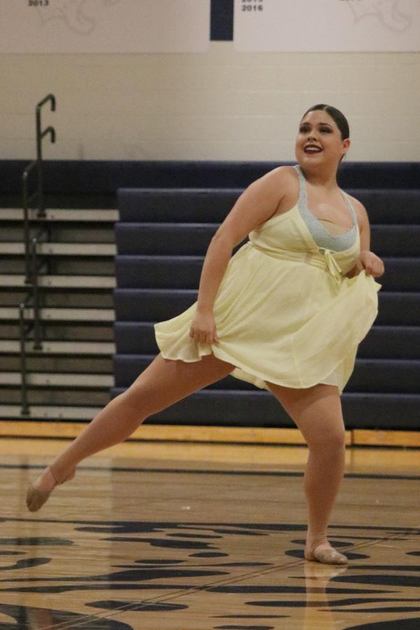 Dancing+in+the+junior+ensemble%2C+junior+Sammie+Pennington+fans+out+her+dress.