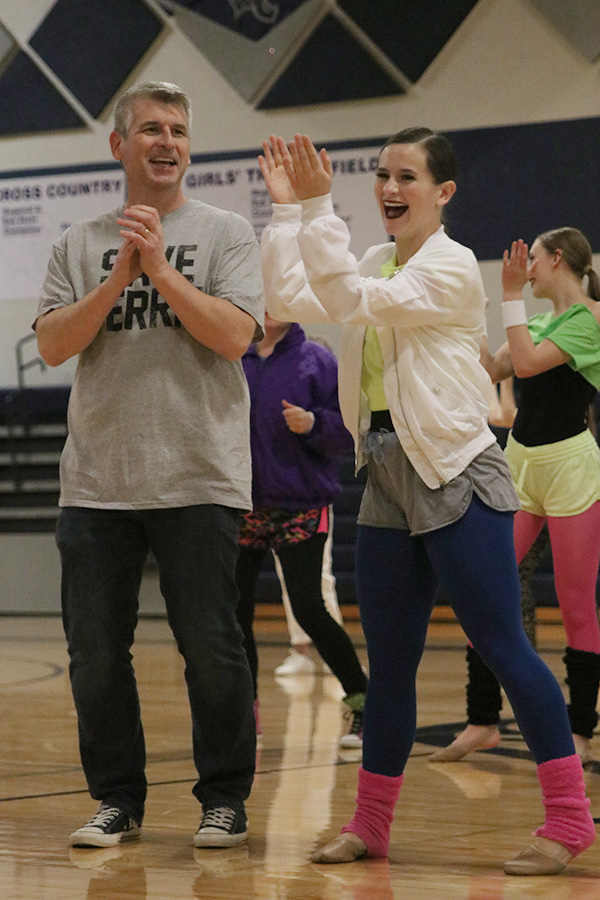 During+the+dads+dance+on+Saturday%2C+March+30%2C+senior+Olivia+Augustine+claps+her+hands+in+laughter.