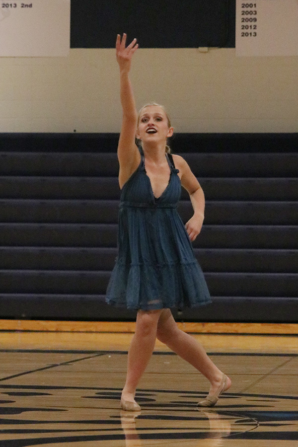 Reaching+her+arm+up%2C+senior+Bella+Line+performs+her+solo+on+Saturday%2C+March+30.