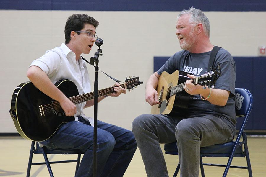 Science teacher Chad Brown picks junior Cael Duffin as his duet partner.