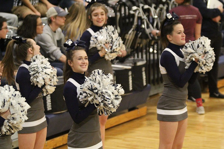 At+the+girls+basketball+substate+game+on+Thursday%2C+Feb.+28%2C+sophomores+Maddy+McDonald+and+Morgan+Botts+cheer+as+the+team+scores.+%22%5BCheer%5D+gets+people+pumped+up+and+...+excited+for+%5Bsporting+games%5D%2C%22+Botts+said.