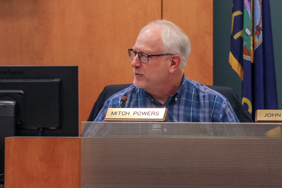 "At the Board of Education meeting on Monday, March 4, board member Mitch Powers voices his concerns to the board and audience members. ""I get concerned about the risk that [will be] taken on by [USD 232] if we were to pass it,"" Powers said."