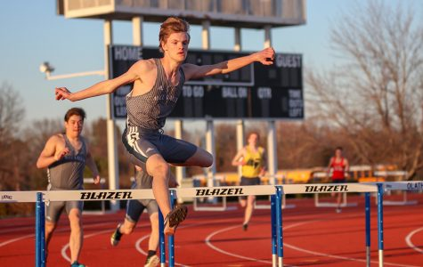 Coming out of turn four in the 300-meter hurdles, sophomore Leif Campbell jumps over the hurdle at the preseason quad meet on Thursday, March 21.