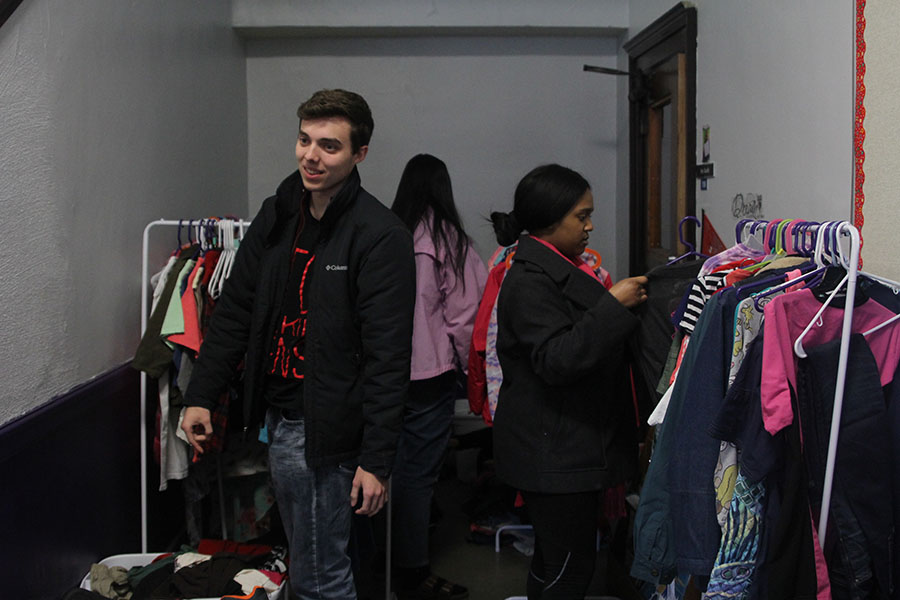 The Youth for Refugees club gathered to sort clothes at the Kansas City International Academy on Wednesday, March 6.  Along with other members of the club, seniors Joe McClain and Jordyn Saunders start organizing the clothes into four different groups. The clothes that were donated will go to children in the school.