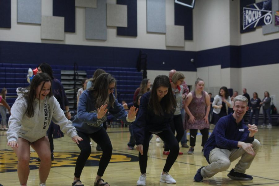 Dancing+to+%E2%80%9CCha+Cha+Slide%E2%80%9D+by+DJ+Casper%2C+junior+Kaitlyn+Gowin%2C+sophomore+Rylee+Fouts%2C+sophomore+Taylor+Bruce+and+senior+Ethan+Males+enjoy+one+of+the+many+activities+at+the+Special+Populations+Prom