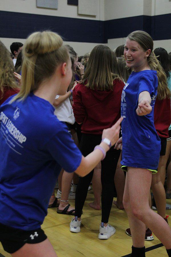 As an ABBA song plays, junior Megan Proctor dances among the crowd.