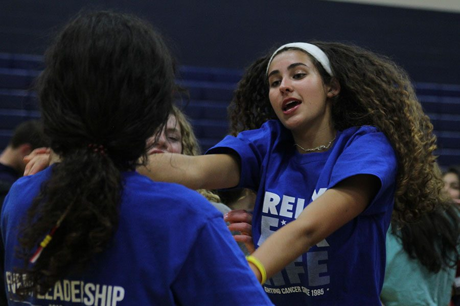 After moving into the auxiliary gym, sophomore Nichole Crist dances to