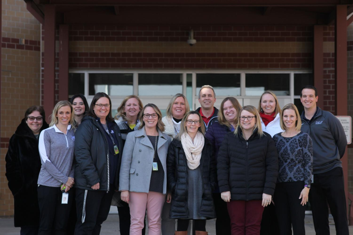 Members of the Executive Leadership team from left to right. Top: Helga Brown, Dorothy Swafford, Trish Chandler, Sara Evans, Jeff Wieland, Sara Sedgwick, Amy Welzenbach, Chris Wallace. Front: Jessica DeWild, Deb Steiner, Erin Hayes, Elizabeth Molgren, Emily Schmidt, Jill Lloyd.