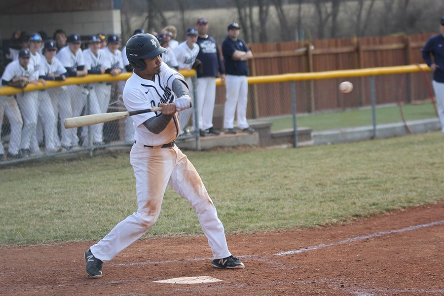 Watching the ball closely, senior Johnathan Contreras prepares to hit.