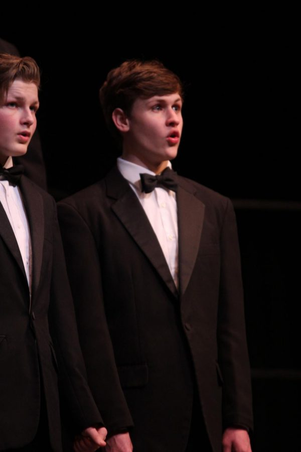 """Beginning the evening, senior Noah Smith performs with the Jag Singers as they sing """"Festival Gloria"""" by Randall Johnson."""