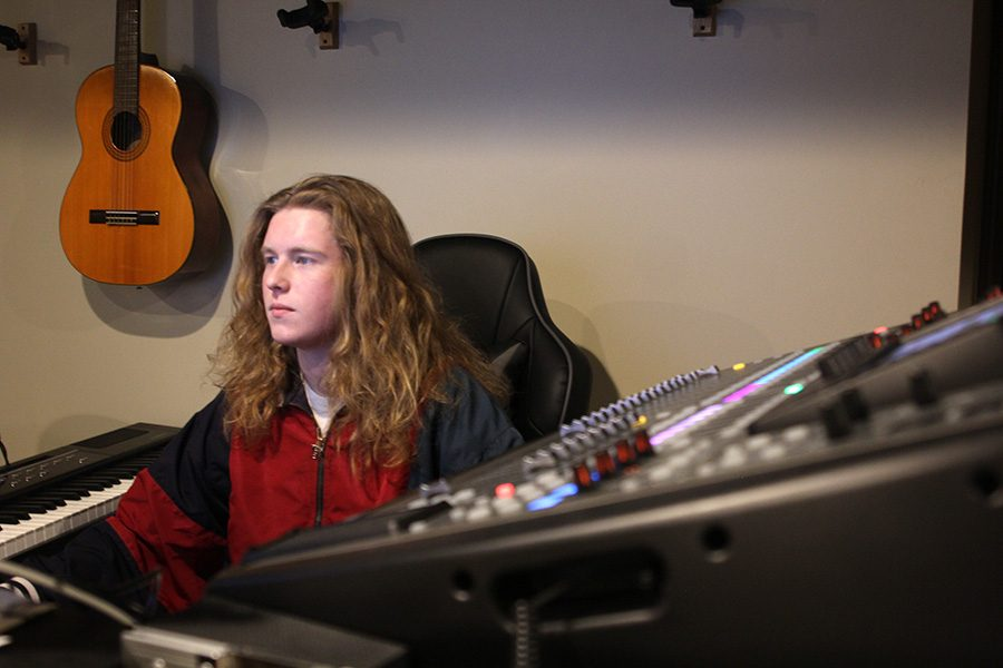 "Surrounded by editing equipment senior Killian O'Brien works on a new single on Tuesday Feb. 26. He uses a variety of equipment and software to make and produce original music. ""I use the Pro Tools software to record [the lyrics] and to make beats I use my phone to record,"" O'Brien said."